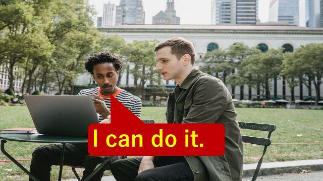 """""""I can do it.""""と仕事の打ち合わせで相手に伝えている会社員"""