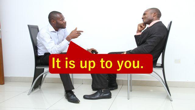 """It is up to you.""と仕事の打ち合わせで相手に伝えている会社員"