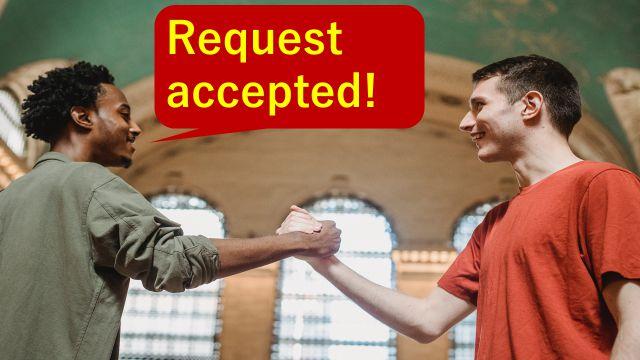 """Request accepted.""と仕事の打ち合わせで相手に伝えている会社員"